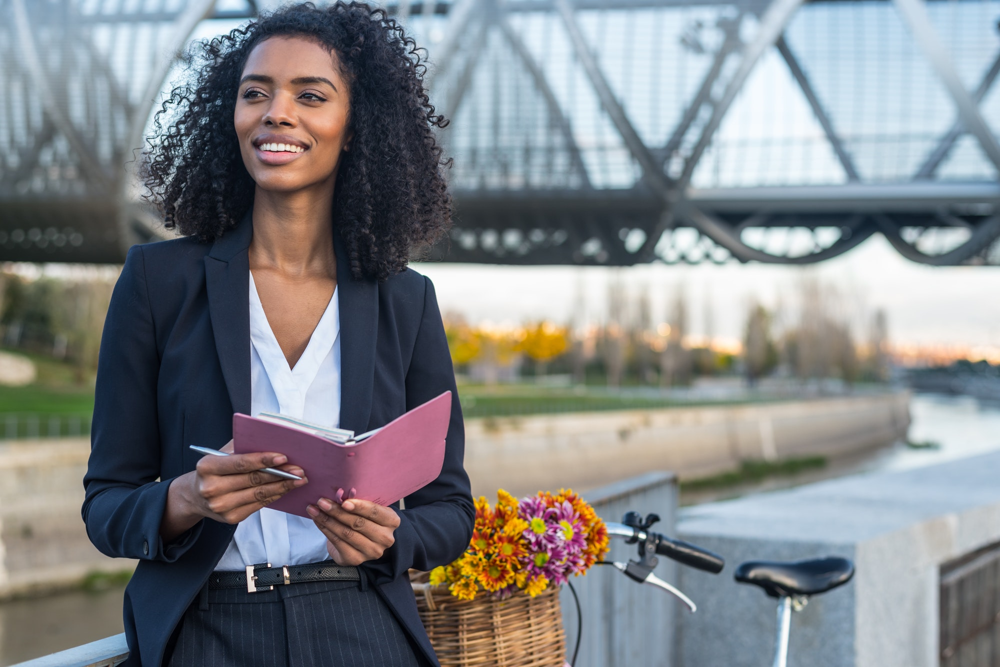 business-black-woman-with-vintage-bicycle-by-the-river-looking-a-1